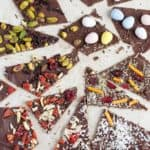Chocolate thins with pistachios, silvered almonds and other topping.