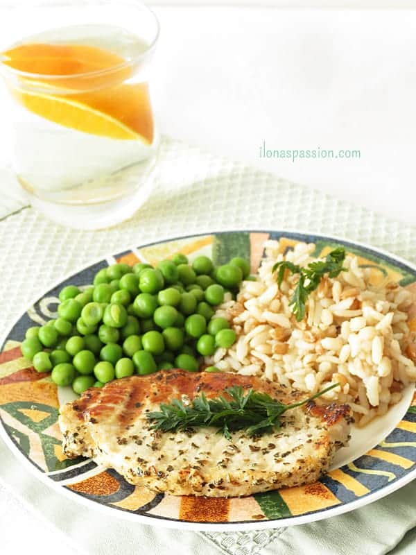 Lemon Basil Pork Chop - Marinated in lemon and basil pork chop is grilled to perfection. Healthy, lemony pork chop is perfect for everyday dinner. Served with rice and green peas by ilonaspassion.com I @ilonaspassion