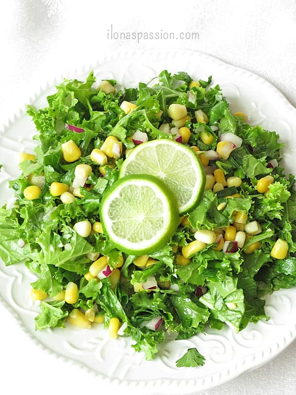 Crunchy Kale Salad with corn, onions and garlic by ilonaspassion.com #kalesalad #kale #recipe