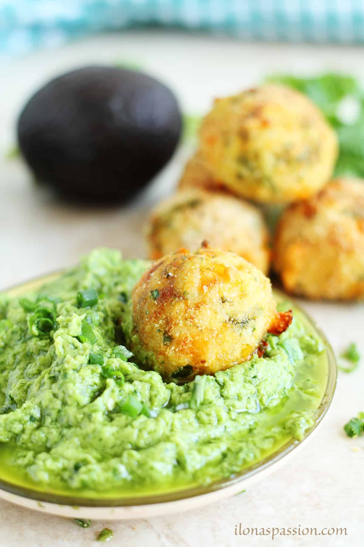 Arancini baked rice recipe topped in creamy avocado cilantro dip.