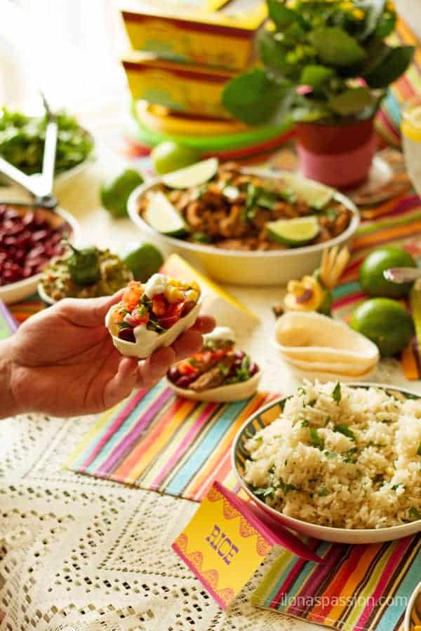 Mexican food recipes menu set up for entertaining with meats and rice.