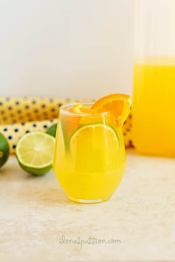 Healthy orange lime refresher recipe made with fresh fruits and sweeten naturally with honey. Cool off with this drink during hot days. by ilonaspassion.com I @ilonaspassion