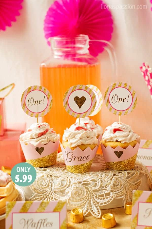 Dulce de leche cupcakes in a pink and gold party set up as first birthday party decor.