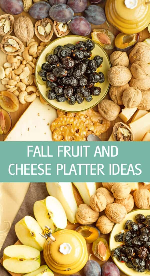 A tray with seasonal fruits, nuts, pretzels and cheese.