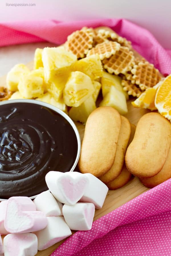 Chocolate fondue ideas with fresh fruits like pineapple, ladyfingers and marshmallows ilonaspassion.com I @ilonaspassion