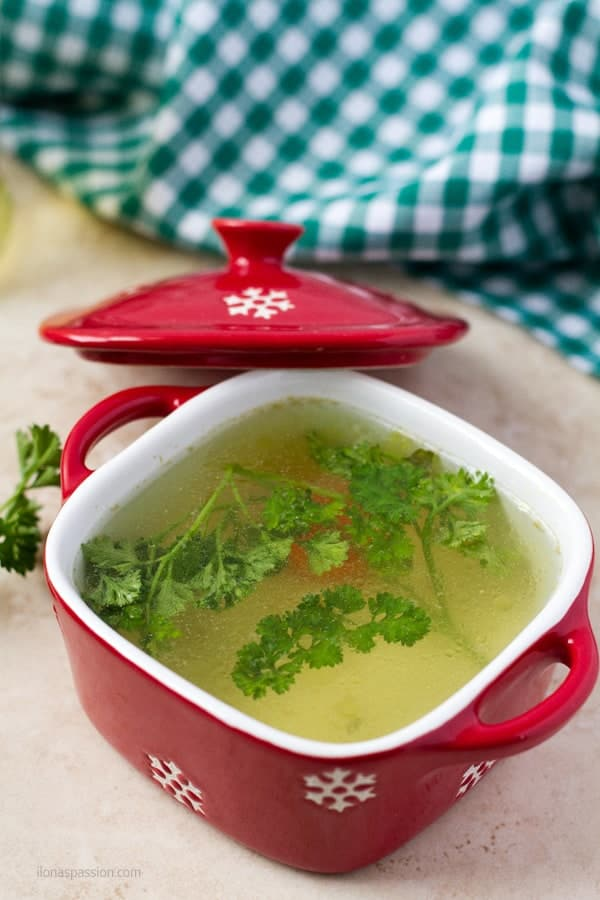 A clear savory meaty liquid with parsley.