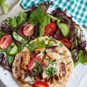 Harissa chicken served on pita bread.