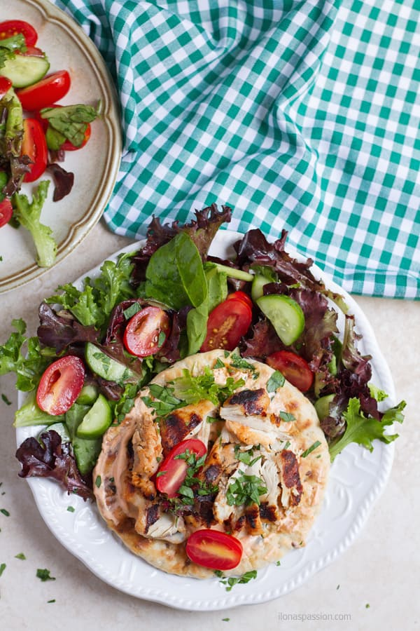Grilled chicken on pita bread with salad.
