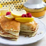 Lemony pancakes with frozen raspberries.